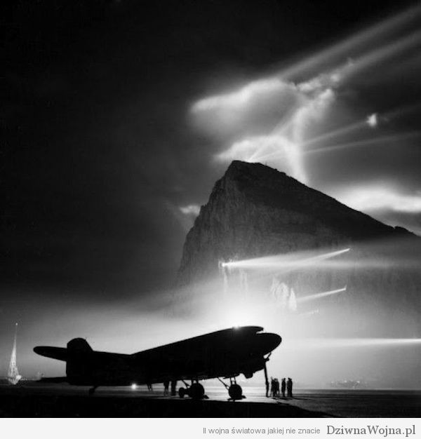 A-Douglas-Dakota-of-the-British-Overseas-Airways-Corporation-at-Gibraltar-silhouetted-by-searchlights-on-the-Rock-1940