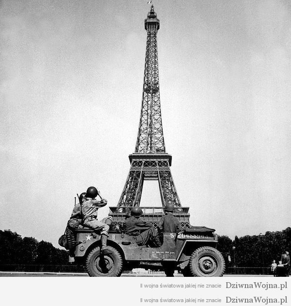Soldiers of the 4th U.S. Infantry Division look at the Eiffel Tower in Paris, after the French capital had been liberated on August 25, 1944. John Downey.