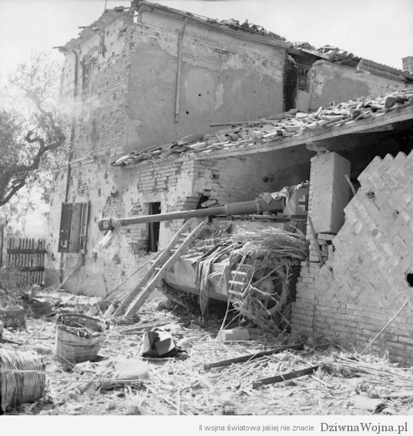 An-abandoned-German-PzKpfw-IV-tank-which-had-been-backed-into-a-house-for-cover-north-of-the-River-Marano-17-September-1944.